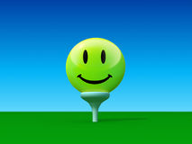 Smiley golf ball on golf yard Royalty Free Stock Photos
