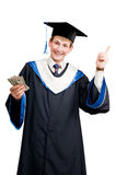 Smiley graduate student in cloak. Young smiley graduate student in cloak with money and thumbs up isolated Royalty Free Stock Photo