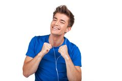 Smiley guy in earphones listening music on white background. Stock Photo