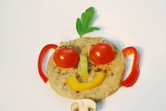 Smiley with hair. Fun food shape on table Stock Photography