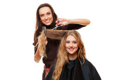 Smiley hairdresser with client Royalty Free Stock Images