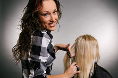 Smiley hairdresser with client Stock Photo