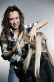 Smiley hairdresser doing hairstyle Stock Image