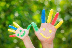 Smiley on hands Stock Image