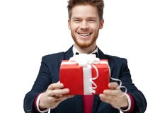 Smiley handsome man offers a gift Stock Images