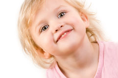 Smiley happy little girl closeup. On white background Royalty Free Stock Photos