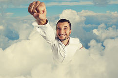 Smiley and happy man flying Stock Photo