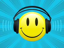 Smiley with headphones. On blue background royalty free illustration