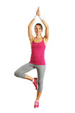 Smiley healthy young woman doing yoga Stock Images