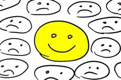 Smiley heureux parmi des smiley tristes illustration libre de droits