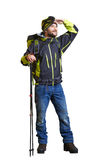 Smiley hiker with backpack and hiking poles Royalty Free Stock Image