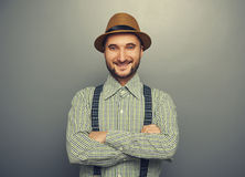 Smiley hipster man over grey background Stock Image