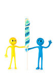Smiley holding colourful lollipop isolated Royalty Free Stock Image