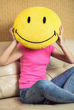 Smiley and a human head. Royalty Free Stock Images
