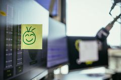 Smiley illustration at the working place, metaphor for feedback and motivation. Feedback and motivation concept: Smiley Illustration at the working place, happy stock images