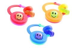 Smiley infant rattles Royalty Free Stock Photography