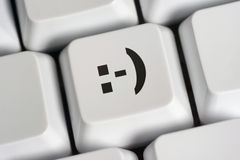 Smiley on key. Smiley on computer keyboard key Royalty Free Stock Photos