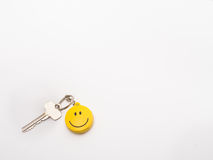 Smiley key chain fob. A smiley key fob, chain and a key to a personal treasure (car, house ect Stock Photography