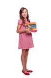Smiley little girl with books Stock Images