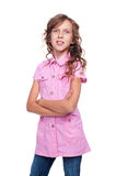 Smiley little girl with curly hair standing Stock Images
