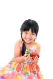 Smiley little girl holding strawberries in hands Royalty Free Stock Images