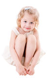Smiley little girl sitting on white Stock Images