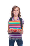 Smiley little student holding some books. Isolated on white background Royalty Free Stock Image