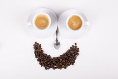 Smiley made from cups of coffee. On white background Royalty Free Stock Image