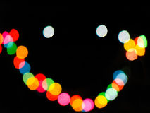 Smiley made from light bokeh. Smiley made from the bokeh of lights of multiple colors Royalty Free Stock Images