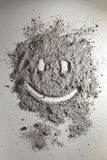 Smiley made of scattered ash. Smiley made of scattered grey ash Royalty Free Stock Photos