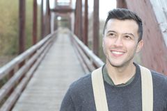 Smiley male walking through a bridge.  Royalty Free Stock Photography