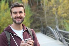 Smiley male walking through a bridge.  Stock Photo