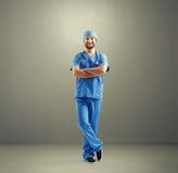 Smiley man in blue medical uniform Stock Photos