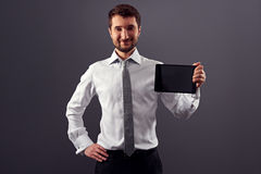 Smiley man in formal wear holding tablet pc Royalty Free Stock Photo