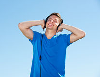 Smiley man in headphones Royalty Free Stock Images