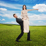 Smiley man holding his woman Stock Photo