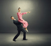 Smiley man holding young woman Stock Photo