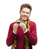 Smiley man holds small cake Stock Image
