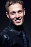 Smiley man over dark background Stock Photos