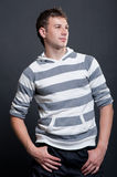 Smiley man in stripy pullover Stock Photos