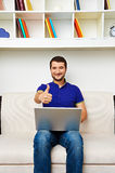 Smiley man working with laptop Royalty Free Stock Image
