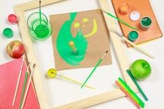 Smiley med målningutrustningar Arkivbild