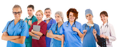 Smiley medical team of eight people Royalty Free Stock Photos