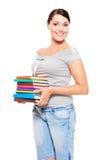 Smiley model holding many-coloured books Royalty Free Stock Image