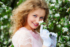 Smiley model posing in white flowers Royalty Free Stock Photo