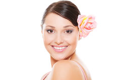 Smiley model with rose in hair Royalty Free Stock Images