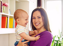 Mother and cute son at livingroom Royalty Free Stock Photography