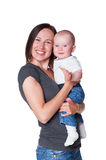 Smiley mother holding her baby Stock Photos