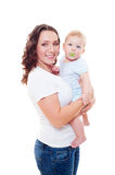 Smiley mother holding her son Royalty Free Stock Images