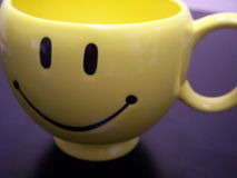 Smiley mug close up. Close up of a smiley face coffee cup royalty free stock images